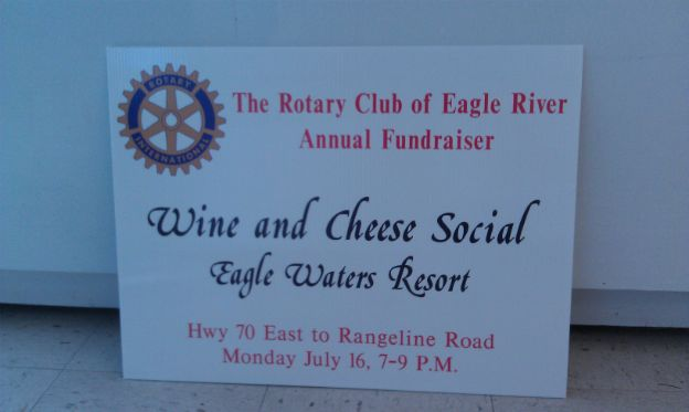 The Rotary Club of Eagle River.  Yard sign promoting an upcoming event.
